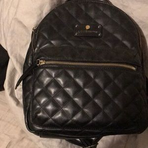 Black waffled textured back pack purse good cond.